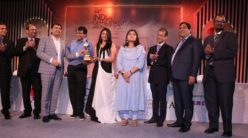 Mr Rajesh Lakhani Director Kiran Gems receiving award for Highest Taxpayer Company